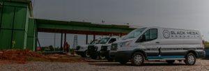 Black Mesa Security service vans parked orderly on job site
