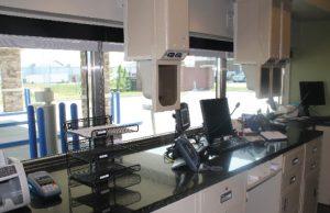 Drive-thru bank teller station receiving regular maintenance