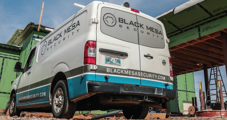 black mesa security service vehicle on job site